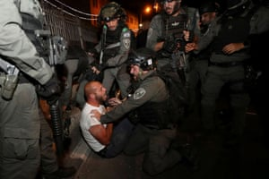 Palestinian protester detained by troops