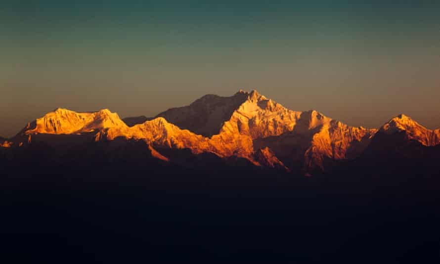 The view of the snow capped peaks of Kangchenjunga, from Tiger Hill in India.
