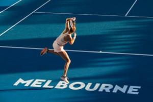 Petra Kvitova leaps awkwardly.