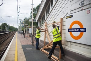 Staff from Groundworks install trellis structures at Brondesbury Park Station as part of the build of the station's energy garden.