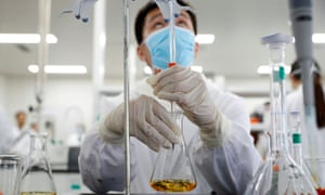 A man works in a laboratory of Chinese firm Sinovac Biotech, which is developing a potential coronavirus vaccine.