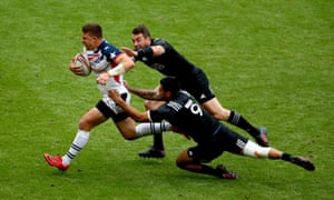 Regan Ware and Kurt Baker of New Zealand tackle Stephen Tomasin of the USA at the London Sevens event at Twickenham.