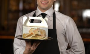 A waiter holding a doggy bag at 34 Mayfair, a restaurant in central London.