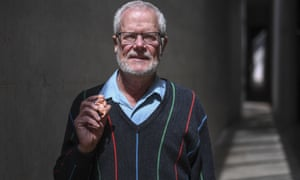 Anti-abortion activist Graham Preston poses for photographs with a model of a 12-week-old foetus outside the High Court