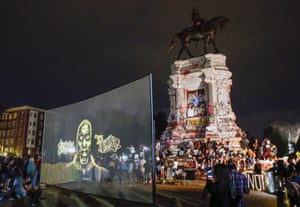 An image of George Floyd is projected on a screen in front of the controversial statue of Confederate General Robert E. Lee in Richmond in July.