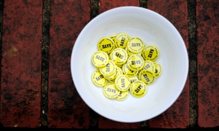 Badges for a campaign to save domestic abuse services