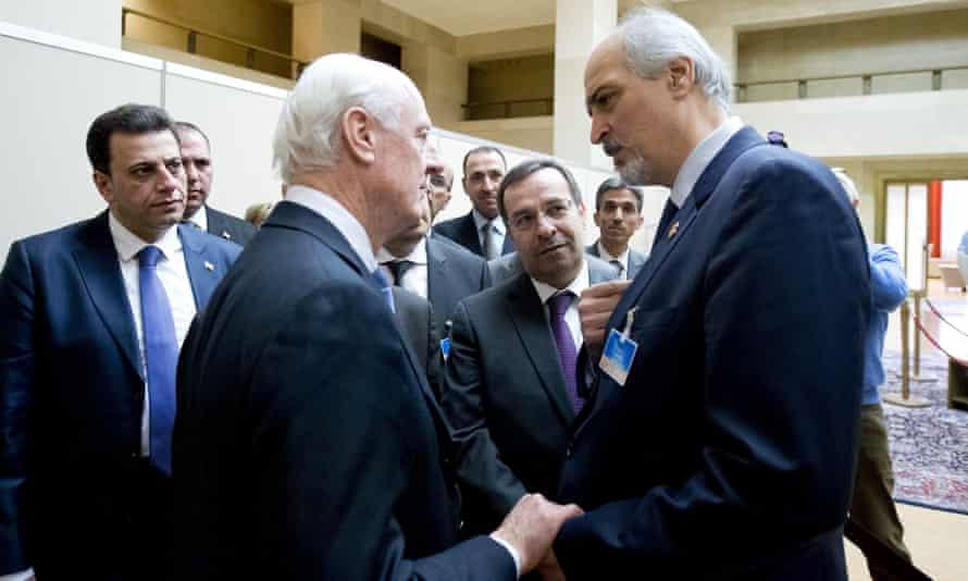 UN special envoy Staffan de Mistura speaks to Syria's ambassador to the UN Bashar al Jaafari during Syria peace talks in in Geneva.