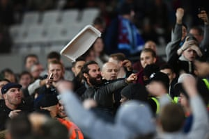 West Ham United and Chelsea fans clash.