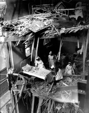 Nurses clearing debris from a wrecked ward at St Peter's Hospital in Stepney, East London, 1941.