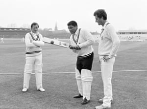 Former world heavyweight boxing champion Muhammad Ali receives instruction in batting techniques from Warwickshire's Dennis Amiss (left) and Bob Willis while the Britannic Assurance County Championship match between Warwickshire and Surrey is played in the background at Edgbaston in May 1984.