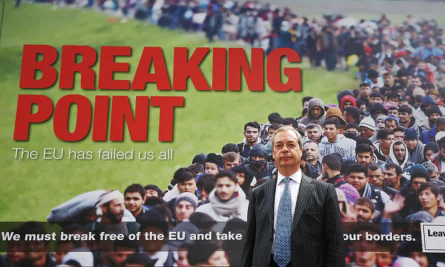 Nigel Farage in front of the poster