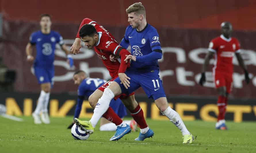 Chelsea's Timo Werner battles with Liverpool's Ozan Kabak.