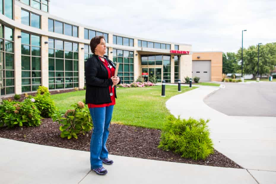Having just finished her rounds, Dr Nancy Zidek stands at the entrance of the newly-opened community hospital in Onaga, Kansas.