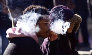 People smoking marijuana during a 420 event in Toronto, as legalization of cannabis approaches this summer.