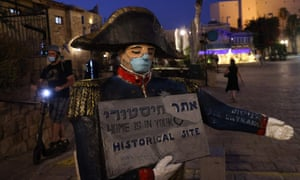 A face mask is painted on a statue of French emperor Napoleon Bonaparte in the Israeli coastal city of Jaffa, south of Tel Aviv, on 2 September 2020.