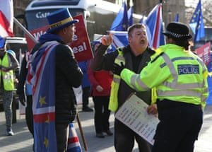 """A leave supporter is spoken to by a police officer as he argues with a remain supporter outside Parliament in London, as police in the area have been """"briefed to intervene appropriately"""" if the law is broken after Tory MP Anna Soubry accused them of ignoring abuse hurled at politicians and journalists."""