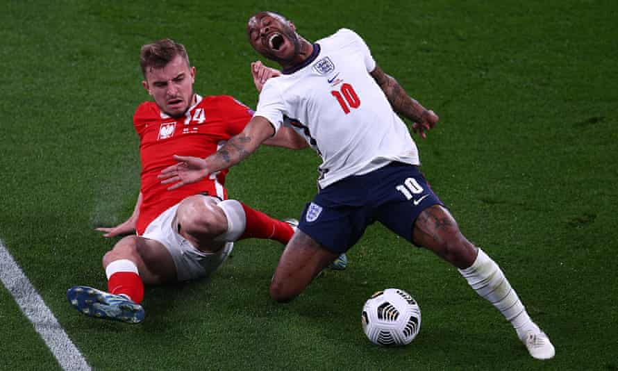 Raheem Sterling is fouled by Michal Helik during England's victory against Poland at Wembley.
