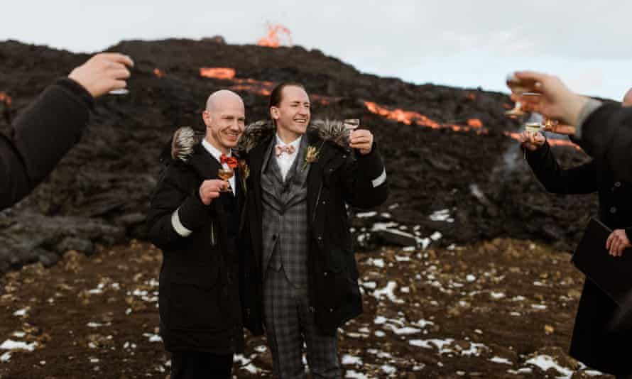 Jón, left, and Sumarliði tie the knot with the dramatic orange lava streams behind them.