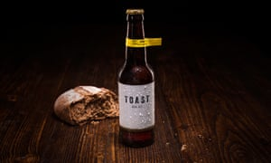 Toast beer and a loaf of bread.