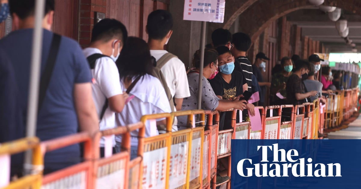 Taiwan raises Covid alert level amid rise in infections