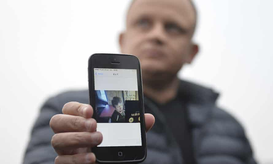 Ariel Żurawski, owner of a Polish trucking company, shows the last photo taken of his cousin and driver, Łukasz Urban.