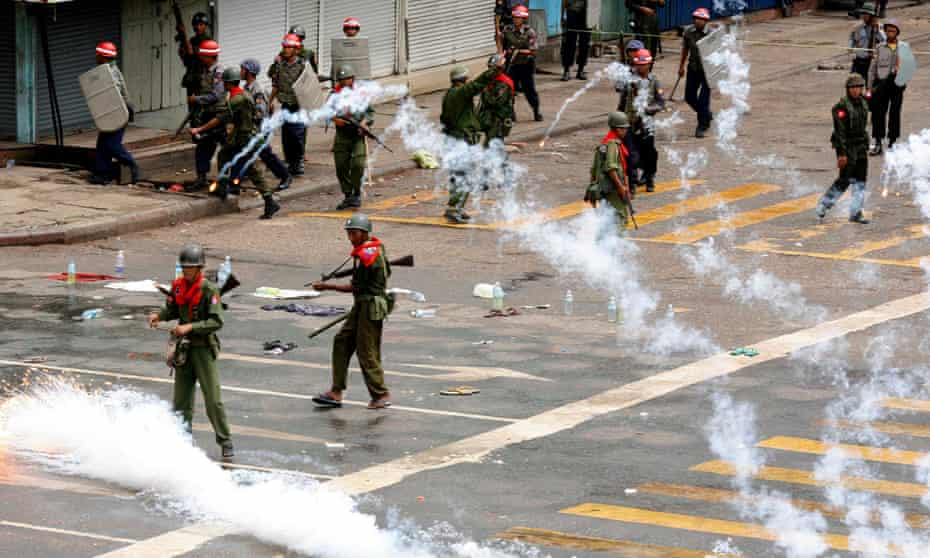 Soldiers release smoke canisters after firing on anti-government protesters in Yangon in 2007.