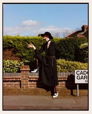 Black polka dot dress, £555, equipment.fr. Metal belt, £289, missoma.com. Black hat, £490, michel-paris.com. White buckle heels, £375, rokeratelier.com. Silver hoops, £182, mondo-mondo.com. Sheer black tights, £14, falke.com