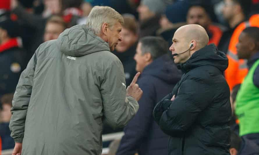 Arsène Wenger argues with fourth official Anthony Taylor during Arsenal's 2-1 victory over Burnley at the Emirates Stadium.