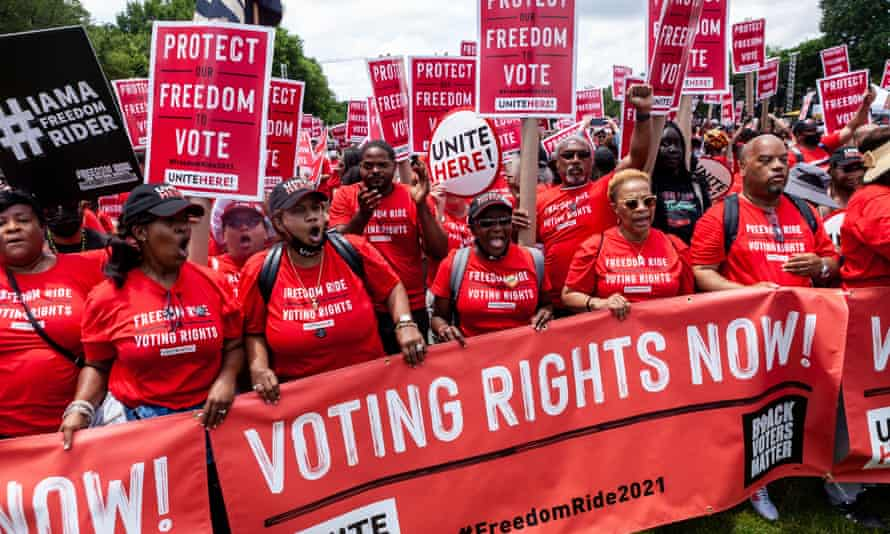 Hundreds of members of Unite Here!, a labor union for hospitality workers, march to the Freedom Ride for Voting Rights on the National Mall on Saturday.