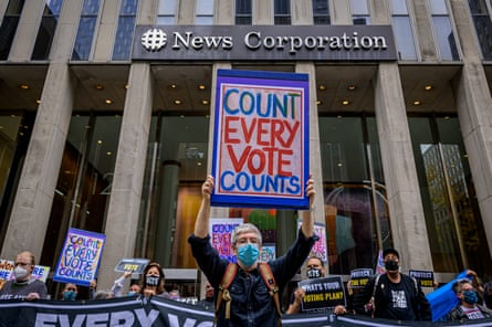 A demonstrator holds a 'Count every vote' sign outside Fox News in New York, New York, on 22 October.