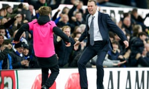 """Everton v Chelsea - Premier League - Goodison Park<br>Everton caretaker manager Duncan Ferguson celebrates with a ball boy after seeing his sides score their third goal during the Premier League match at Goodison Park, Liverpool. PA Photo. Picture date: Saturday December 7, 2019. See PA story SOCCER Everton. Photo credit should read: Nigel French/PA Wire. RESTRICTIONS: EDITORIAL USE ONLY No use with unauthorised audio, video, data, fixture lists, club/league logos or """"live"""" services. Online in-match use limited to 120 images, no video emulation. No use in betting, games or single club/league/player publications."""