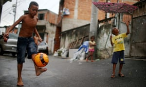 A boy shows off his soccer skills in the Alemão favela complex.