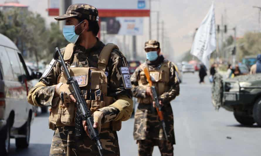 Taliban forces stand guard at a roadside checkpoint in Kabul, Afghanistan, on Thursday.