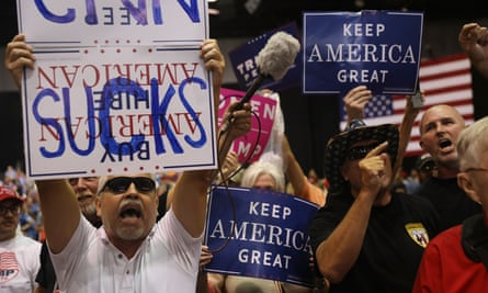 Anti-CNN signs held aloft at a Donald Trump rally in Tampa in July.