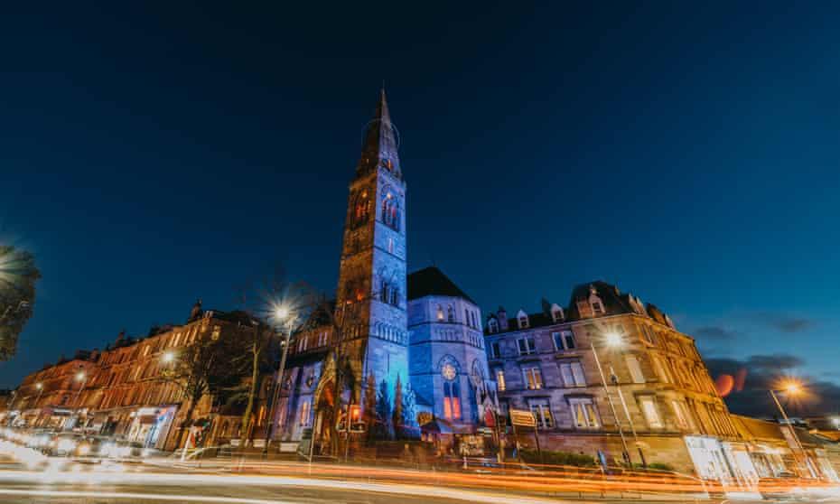 Nighttime street shot of Òran Mór arts venue is in a former church, Glasgow, UK