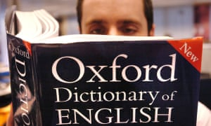 Seeking mansplanation … a man consults the Oxford Dictionary of English.