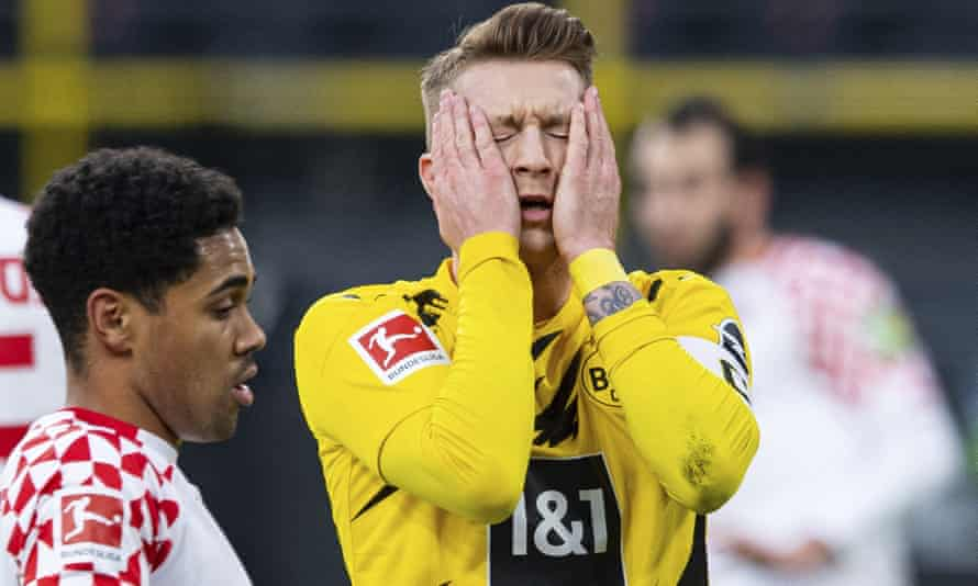 Marco Reus despairs after his missed penalty in Dortmund's 1-1 home draw against Mainz