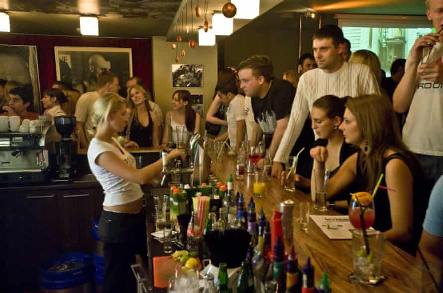 People drinking at a bar in Vilnius.