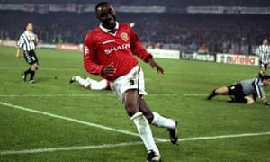 Andy Cole wheels away in delight after scoring.