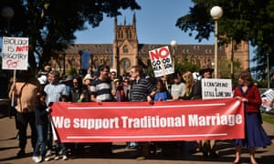 Protesters hold up banners at an anti same-sex marriage rally in Sydney.