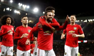 Manchester United's Juan Mata (centre) celebrates scoring his sides third goal with teammates.