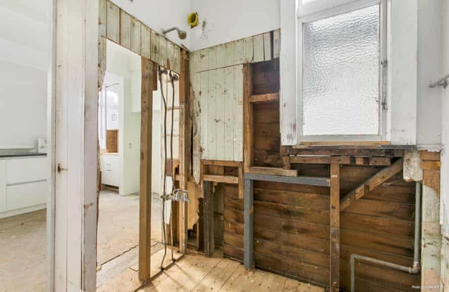 A rudimentary shower inside the house