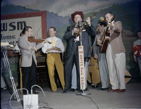Bill Monroe on stage at the Grand Ole Opry, Nashville, c.1958.
