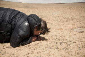 In the northern province of Haixi, geologist, explorer and environmental activist Yang Yong studies the desertified sand on the steppe.