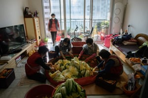 Friends make kimchi, a traditional communal process known as kimjang, in Lee Young-ja's home
