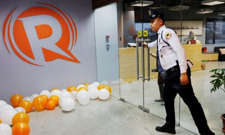 A guard opens a door at the office of Rappler in Pasig, Metro Manila, Philippines.