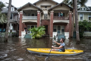 Justin Hand navigates floodwaters in Jacksonville