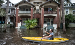 Justin Hand kayaks through Jacksonville after record flooding from storm surges after Hurricane Irma