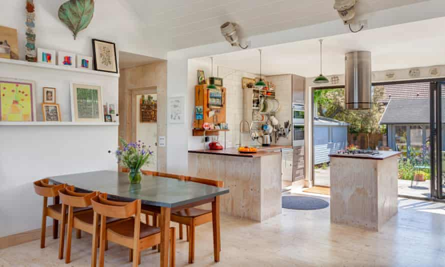 Old meets new: the kitchen cupboards from the original bungalow were retained and repainted.
