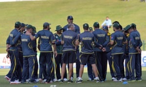 Pakistani cricketers gather prior to start of the fourth day-night international match between Pakistan and New Zealand at the Zayed International Cricket Stadium in Abu Dhabi.